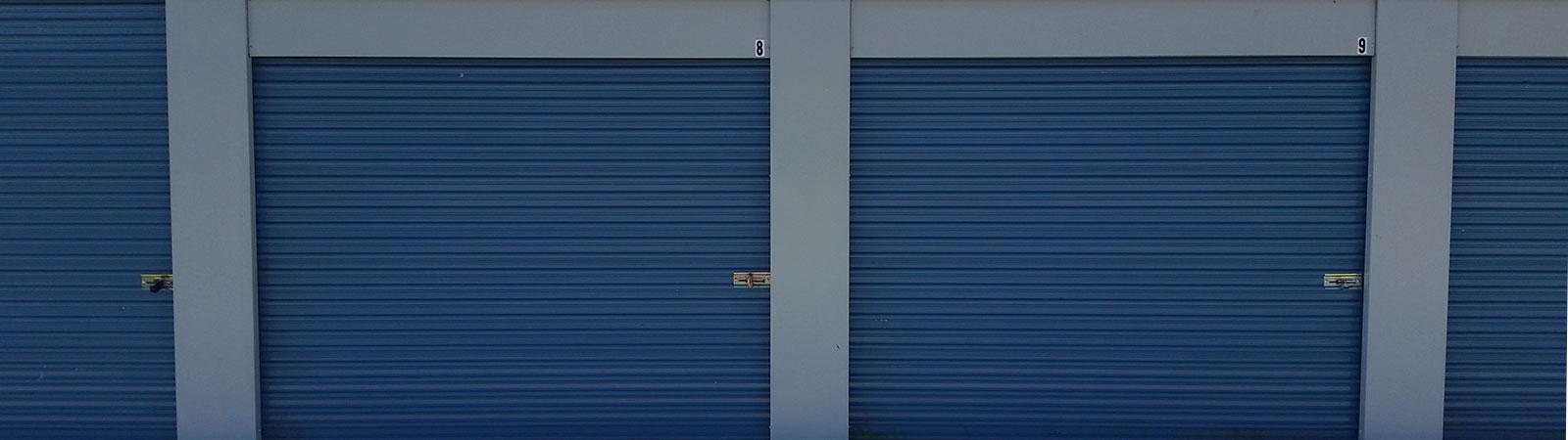line of overhead doors on storage units